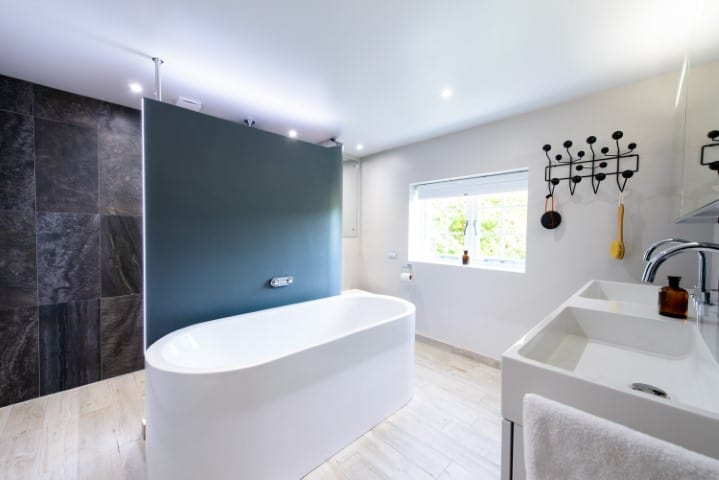 Photo of award winning bathroom with walk in shower and central feature bath